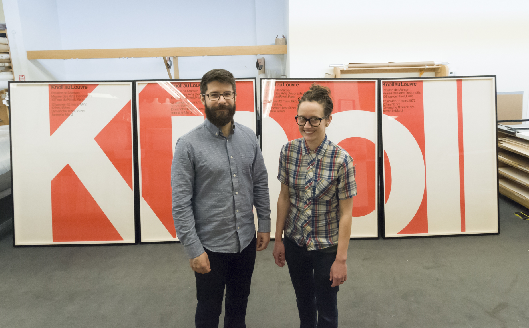 Conservation staff pose in front of framed Knoll posters