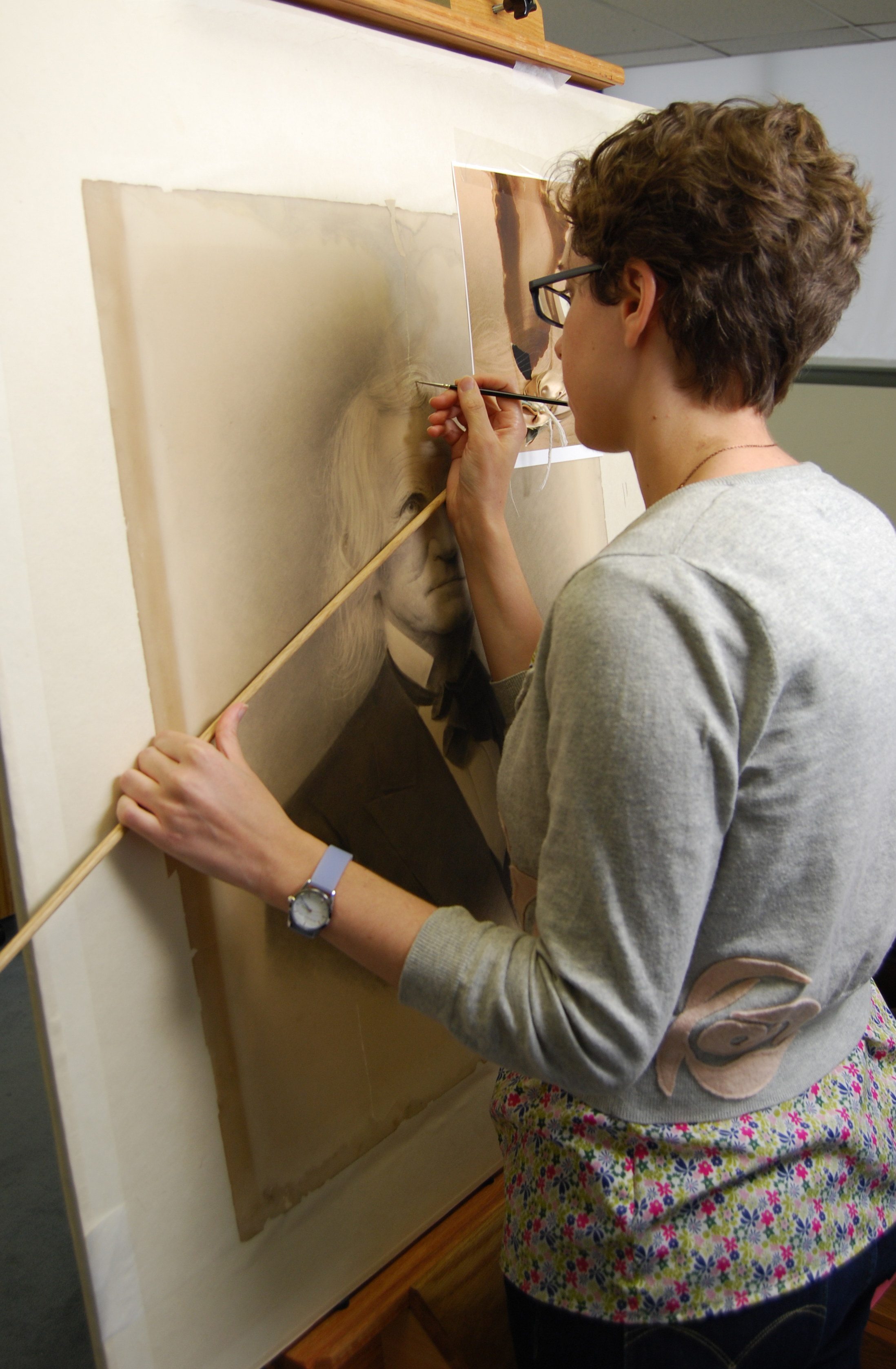 Conservator inpainting losses at easel