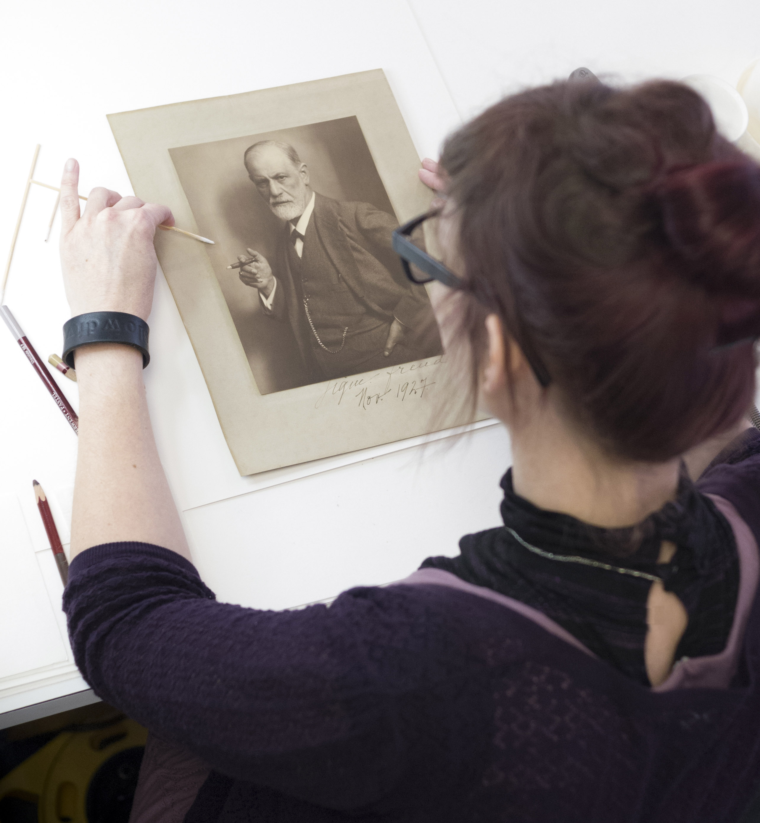 Conservator removes stain from photograph of Freud