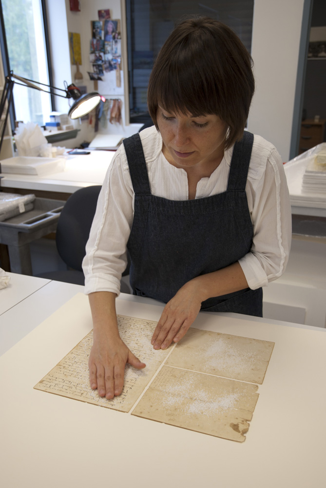 Conservator surface cleans historic document
