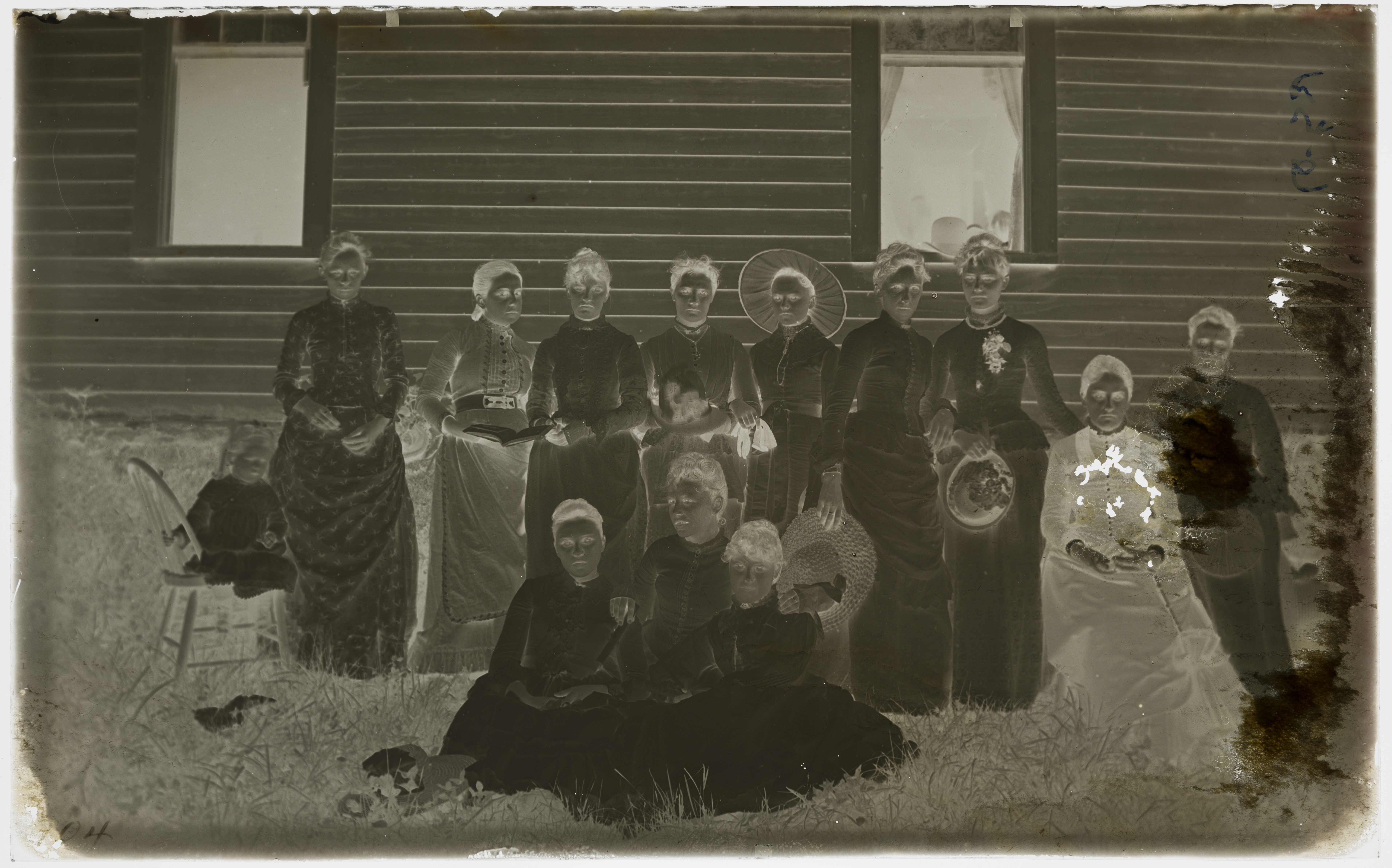 A glass plate negative of a group portrait by O.G. Felland.