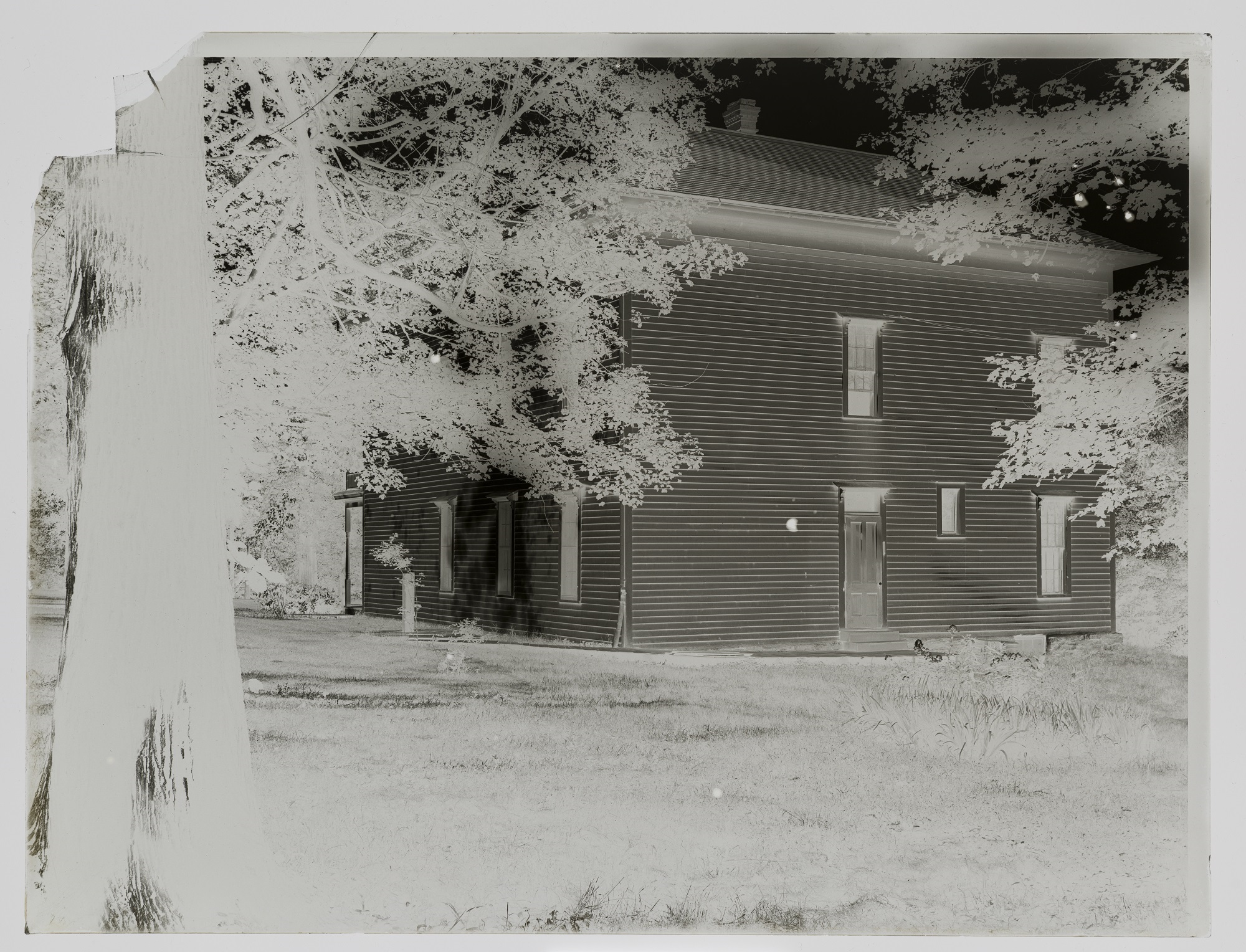 A glass plate negative of a St. Olaf campus building by O.G. Felland.