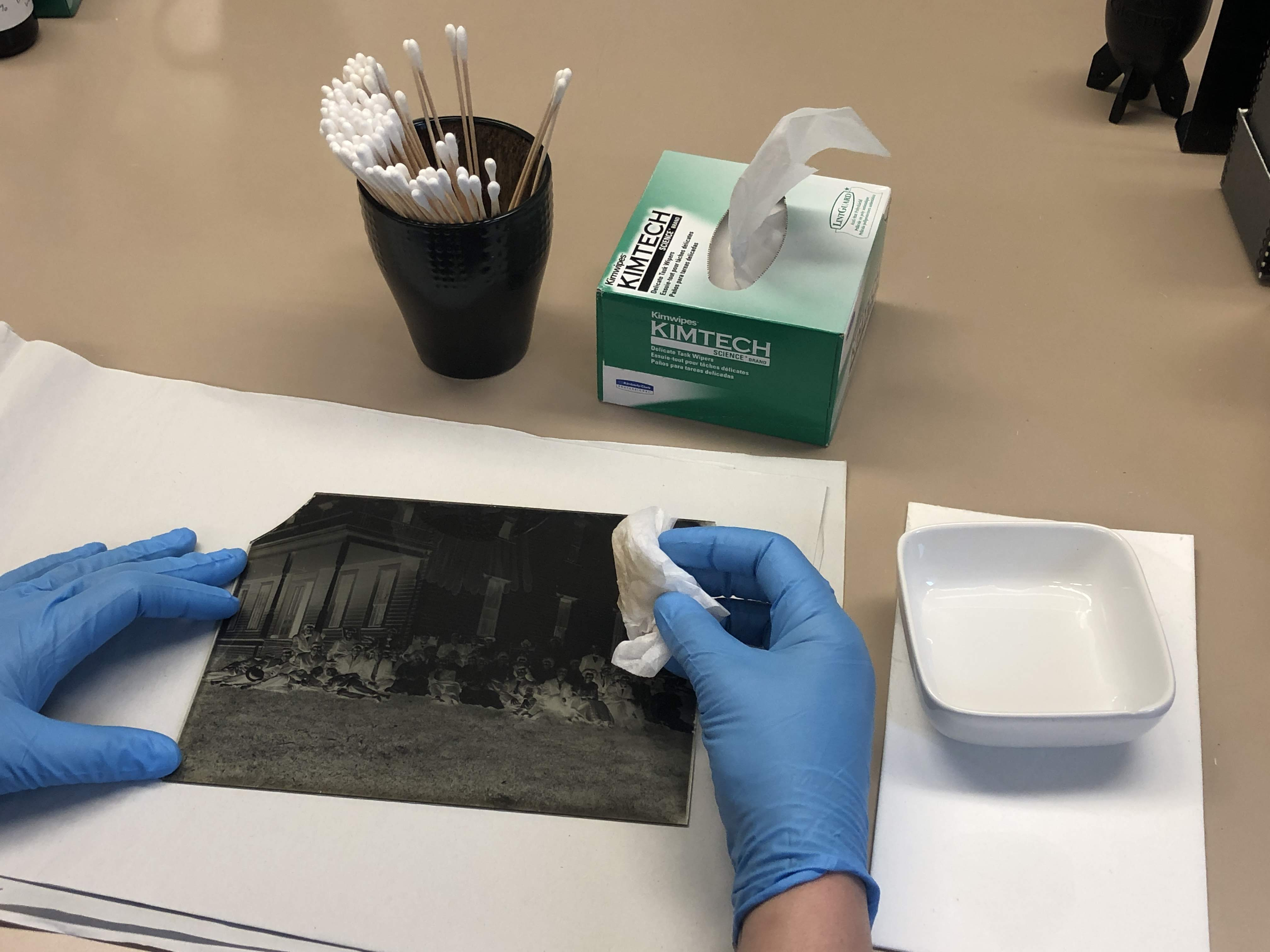 CCAHA staff preparing a negative for shipment