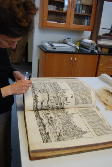 Surface cleaning the pages of the manuscript