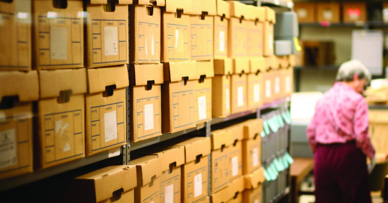 Shelves of archival boxes in a storage space