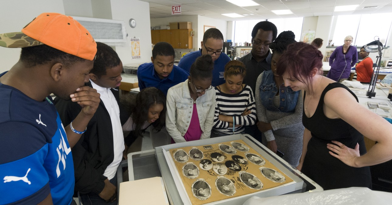 HBCU students examine photographs