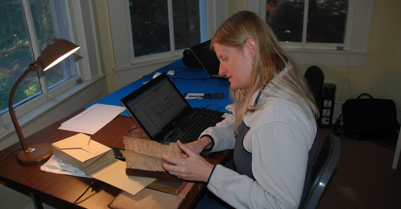 Conservator assessing a volume