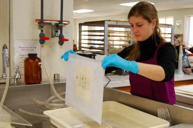 Conservator lifts document from bath