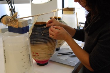 Conservator works on paper lanterns