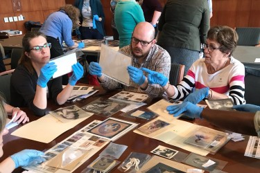 Workshop participants examine photographs