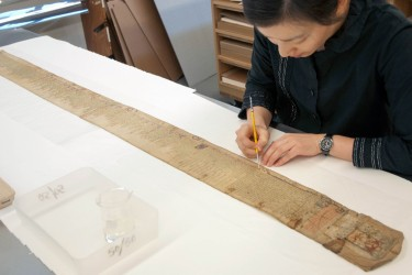 Conservator treats long scroll