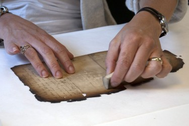 Surface cleaning a burned document