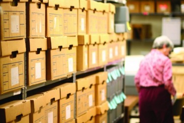 Shelves of archival boxes in storage space