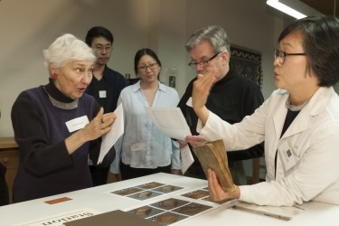 Book Conservator Theresa Cho talks to guests at the 2019 Open House